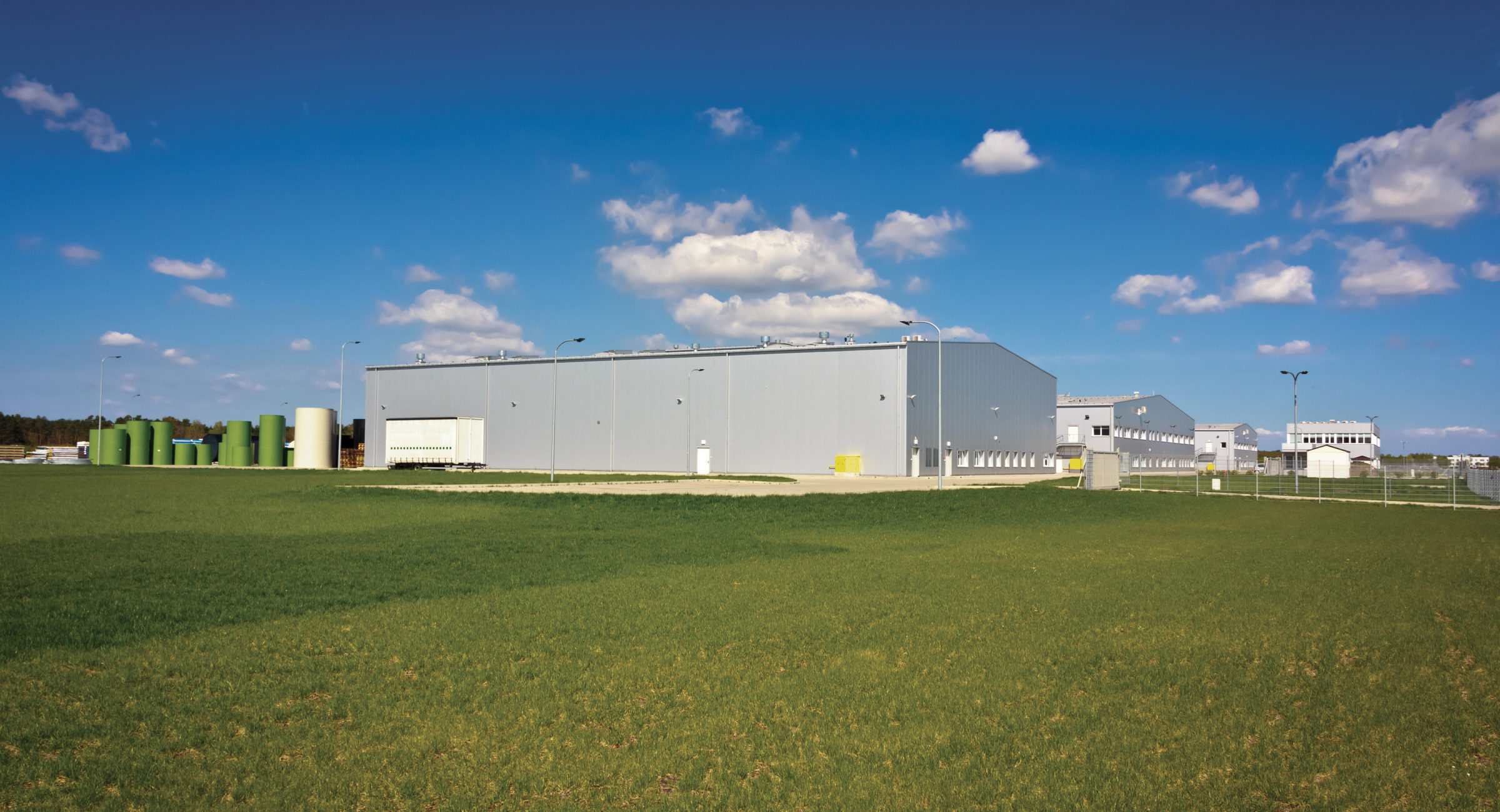 Warehouse buildings on green fieldSee more BUILT STRUCTURE images here: